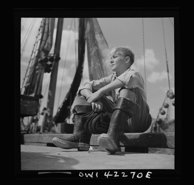 Gloucester, Massachusetts. A young Gloucester boy, probably a fisherman of tommorrow, because many of the boys follow their forefathers as fishermen in the New England waters