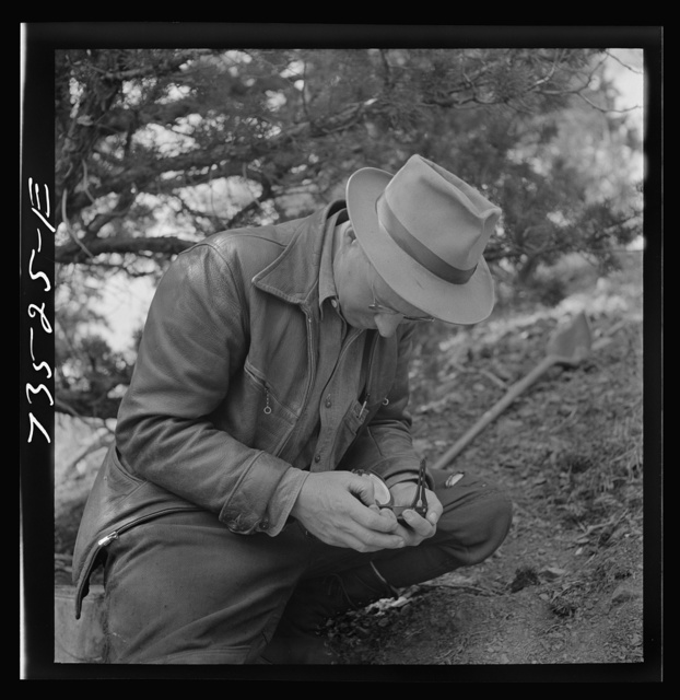 Grant County, Oregon. Bureau of Mines representative taking bearing on angle of diamond drilling for chrome ore deposits