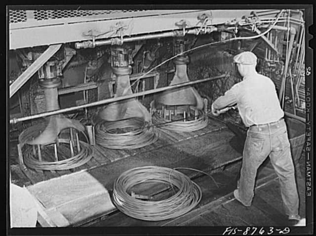 Great Falls, Montana. Anaconda Wire and Cable Company. After copper wire is drawn through various dies to the desired size, it is formed into coils by a fishtail winder