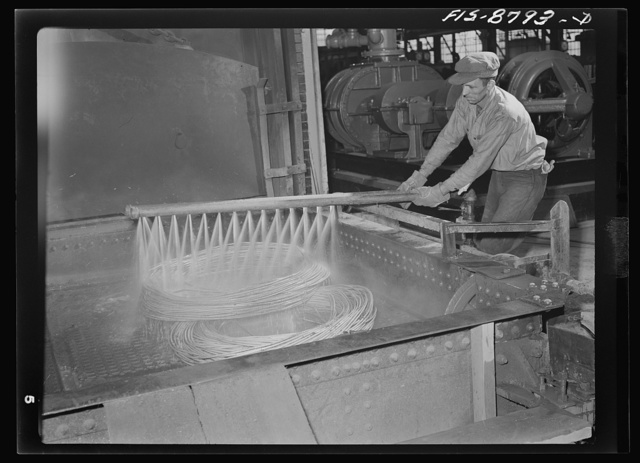Great Falls, Montana. Anaconda Wire and Cable Company. After the annealing process, the treated wire is washed in water