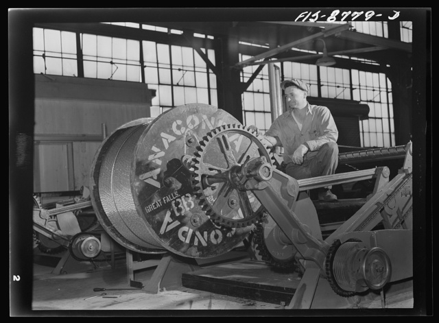 Great Falls, Montana. Anaconda Wire and Cable Company. Reel of hollow conductor cable at end of stranding machine