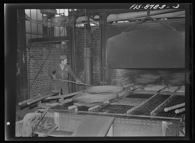 Great Falls, Montana. Anaconda Wire and Cable Company. Removing annealed wire from furnace; in this furnace, wire is heated and held to temperature for a predetermined time; by this means wire which is soft and pliable is produced; by further drawing, various degrees of softness and pliablility are produced in the final wire