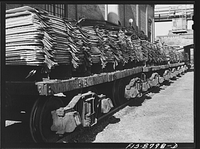 Great Falls, Montana. Anaconda Wire and Cable Company. Trainload of copper cathodes, practically 100% pure copper; these cathodes are moved to the furnace refinery where they are melted down and cast into shapes suitable for the rolling mills and other uses