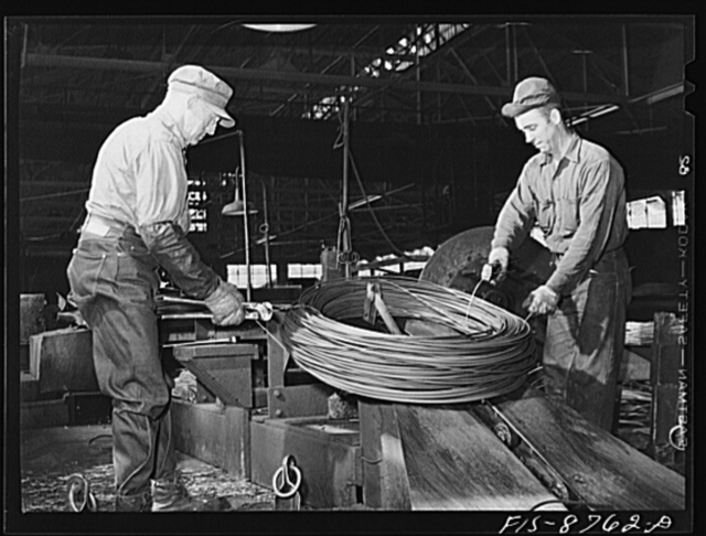 Great Falls, Montana. Anaconda Wire and Cable Company. Tying up roll of copper wire