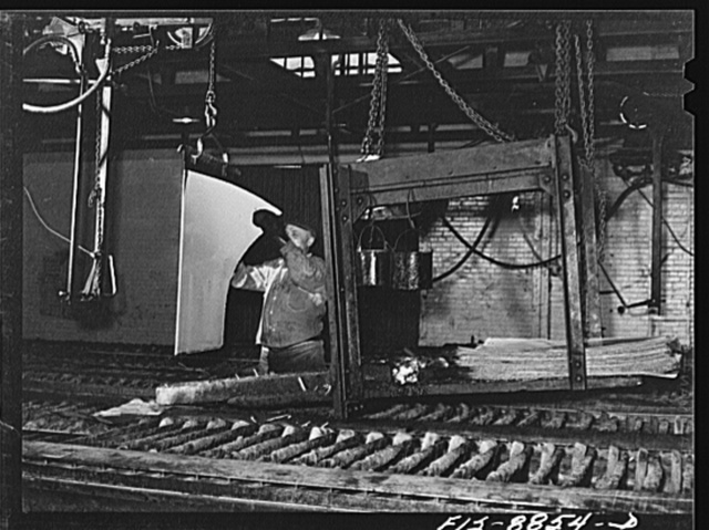 Great Falls, Montana. Electrolytic copper refinery of Anaconda Copper Mining Company. Preparing starting sheets; the workman is shown stripping the starting sheet of electrolytic copper; this copper has been deposited on a rolled copper blank, which has been lightly greased so as to prevent the deposit from adhering; to this starting sheet, loops will be attached for suspension in refining tank