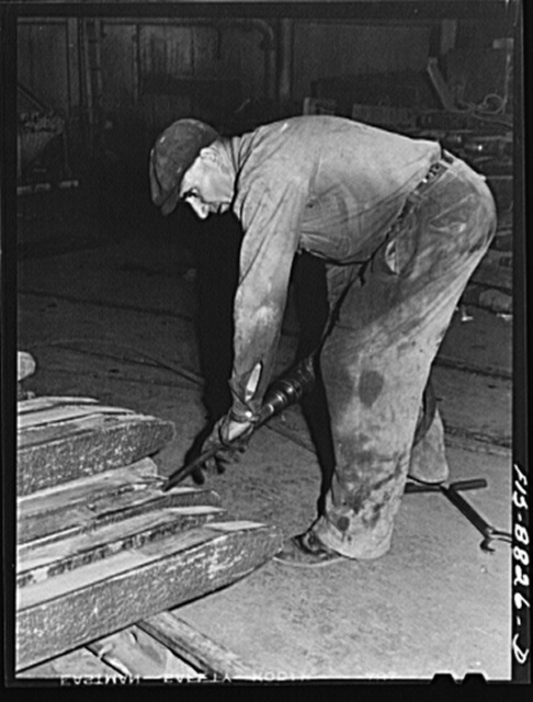 Great Falls, Montana. Furnace refinery of Anaconda Copper Mining Company. Cutting a chip out of a wire bar - a further inspection of this product