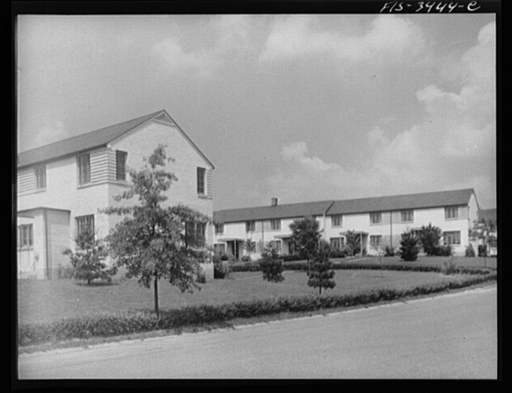 Greenbelt, Maryland. Federal housing project. Two rows of gable-roofed houses on Ridge Road, showing front and backyards. Tenants must maintain their own grounds. All washing must be taken down from the outside lines by 4:00 p.m.