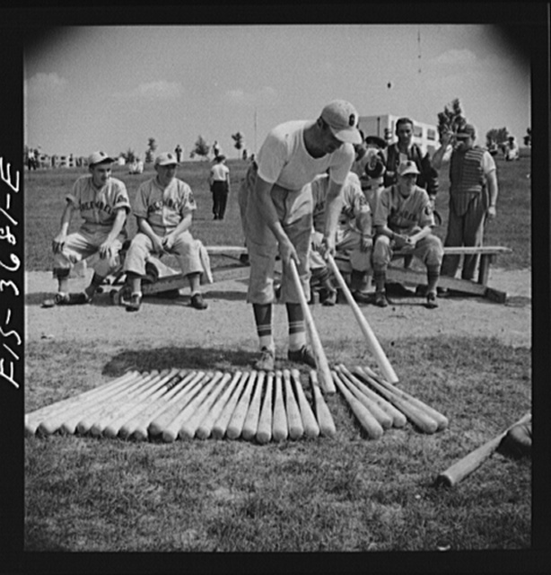 Greenbelt, Maryland. Member of the Greenbelt baseball team picking out a bat. On Sunday the team plays that of a neighboring town