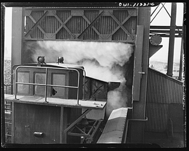 Hanna furnaces of the Great Lakes Steel Corporation. Steam rising in quenching tower after water has been poured onto the live coke