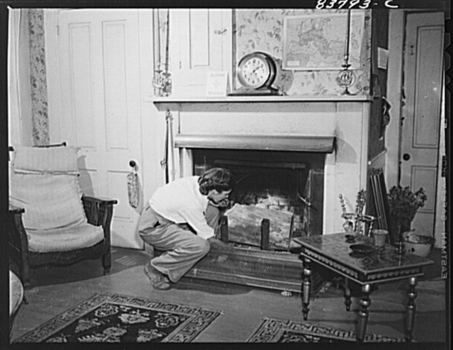 Hartford, Connecticut (vicinity). Living room on the Komorosky farm. On mantel is a clock presented to the Captain for salvaging a tanker for the Standard Oil Company