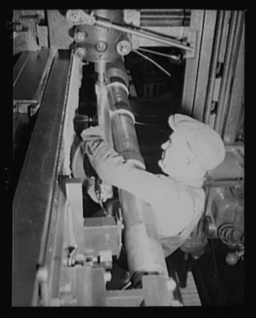 Heavy hardware. Building the slide seats for medium-caliber guns being produced for national defense in an eastern arsenal