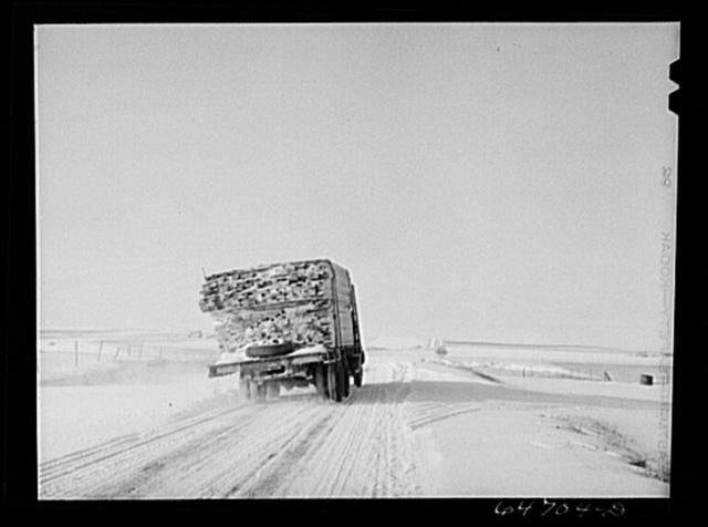 Hettinger County, North Dakota. Lumber truck on the treeless plains