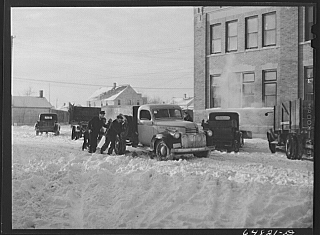Hettinger, North Dakota. Pushing a truck stuck in the snow