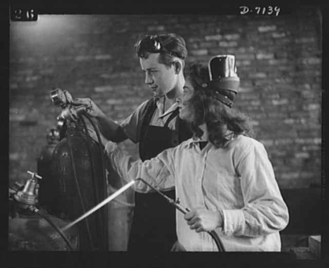 High school Victory Corps. Bill Wood helps Betty Kemp adjust an oxygen gauge in the welding class at Montgomery Blair High School, Silver Spring, Maryland. Betty is one of four girls in a class of twenty seniors who are preparing to help fill industry's need for skilled welders
