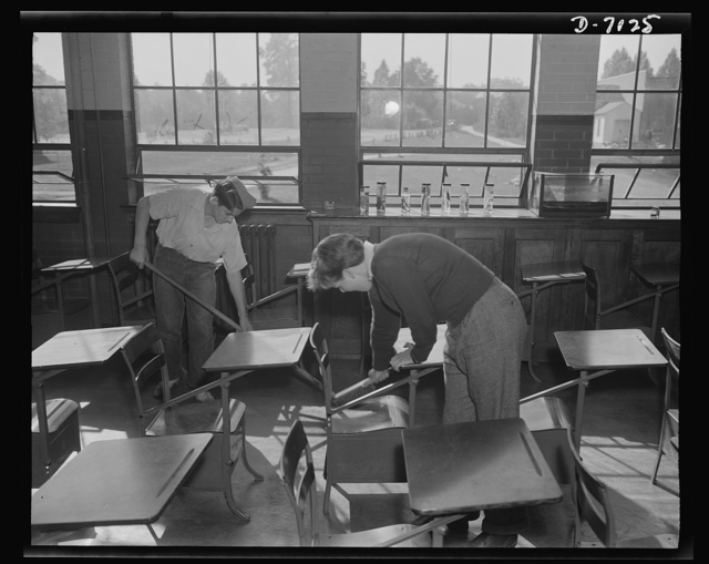 High school Victory Corps. James Parsley and Bill Sabin do their clean-up chores for the day in Montgomery Blair High School, Silver Spring, Maryland. Because of labor shortage, Victory Corps members at Montgomery Blair are taking over some of the janitor, mechanical and electrical repair activities at the school
