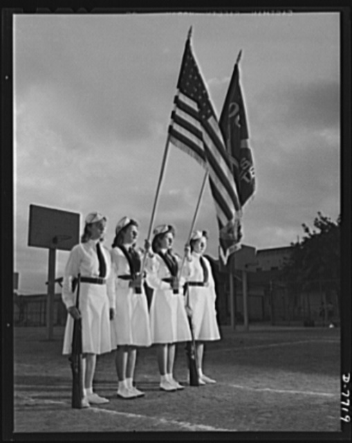 High school Victory Corps. Standing at ease are the members of the girls' team of Roosevelt High School, Los Angeles, California. Rifle practice is one of the school's Victory Corps