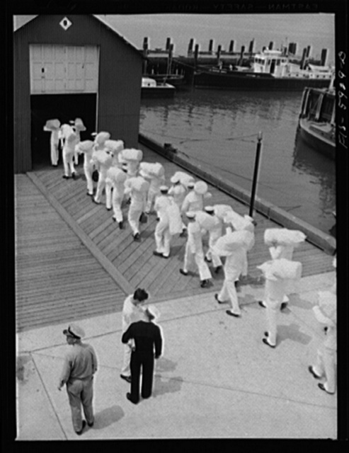 Hoffman Island, merchant marine training center off Staten Island, New York. Group of trainees leaving for a month on one of the training ships