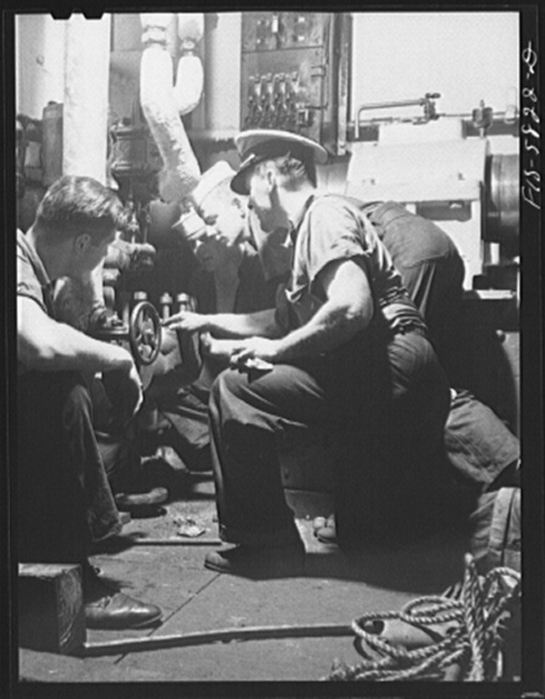 Hoffman Island, merchant marine training center off Staten Island, New York. Instructor with group of trainees in the engine room of the training ship New York