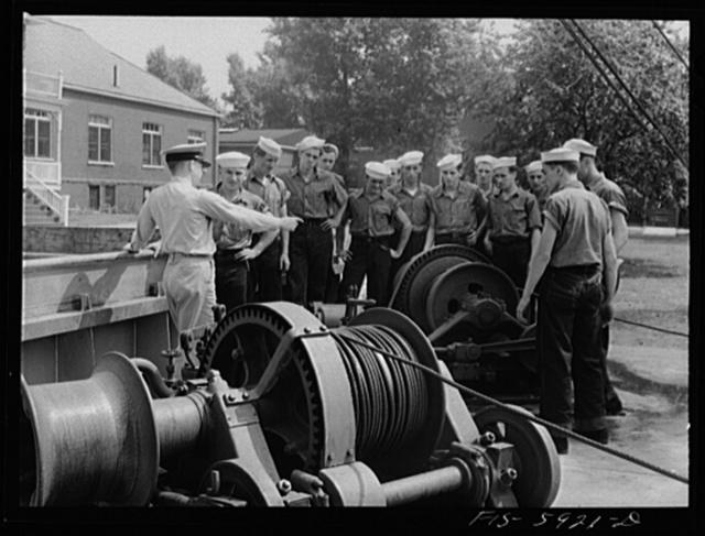 Hoffman Island, merchant marine training center off Staten Island, New York. Mr. Conney instructing a class in how to fix bosun's chair