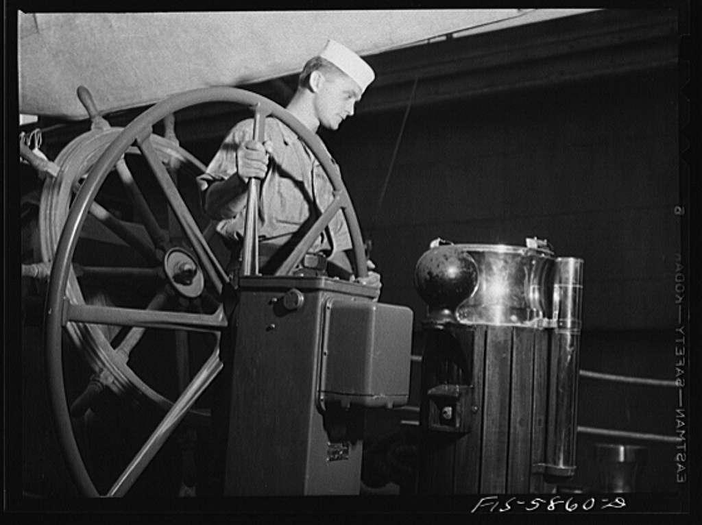 Hoffman Island, merchant marine training center off Staten Island, New York. Trainee at wheel of schooner Vema