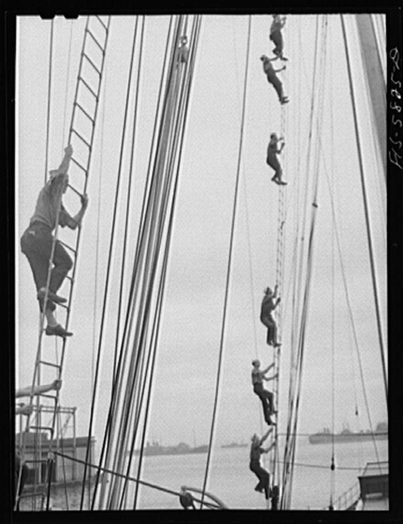 Hoffman Island, merchant marine training center off Staten Island, New York. Trainee climbing to the tops of the schooner Vema on which they have a month's training