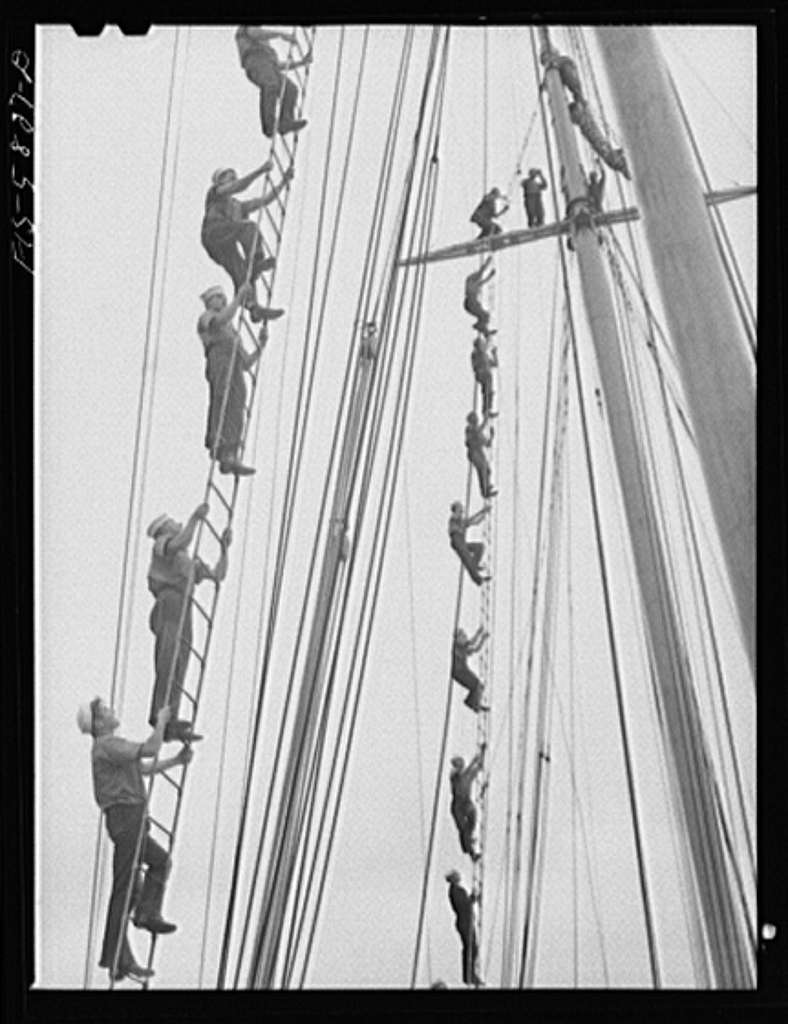 Hoffman Island, merchant marine training center off Staten Island, New York. Trainees climbing to the tops of the schooner Vema on which they have a month's training period