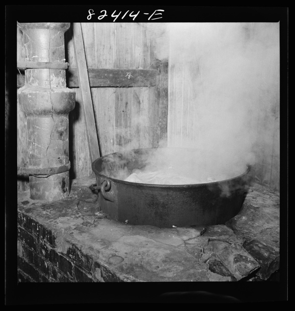 Honey Brook, Pennsylvania (vicinity). Boiling down meat scraps which remain from butchering on an Amish farm