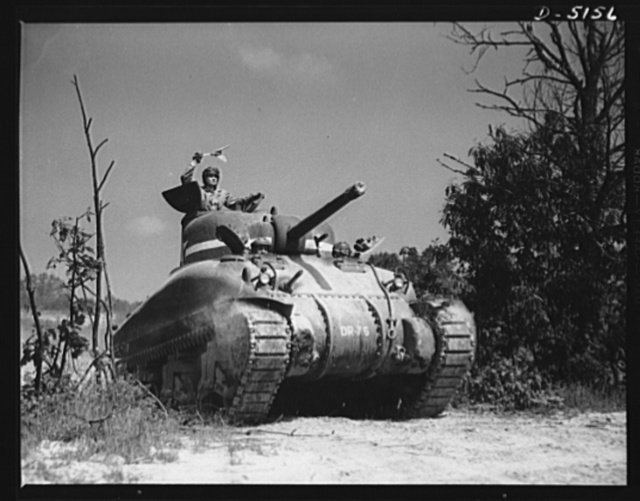 """In the massive cast-steel hull of this M-4 tank, a crew of hard-bitten """"tankers"""" is rehearsing a few fighting tricks at a training school of the armored forces at Fort Knox, Kentucky"""