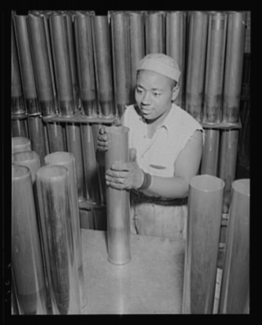 Individual attention for the big shells. Visual inspection during manufacture of shells for the Army's new guns. Thousands of these are coming down the production lines at a large eastern arsenal