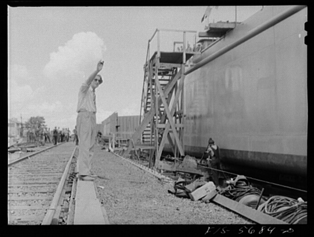 Ingalls Shipbuilding Company, Decatur, Alabama. Signaling to let go an Army barge and launch her