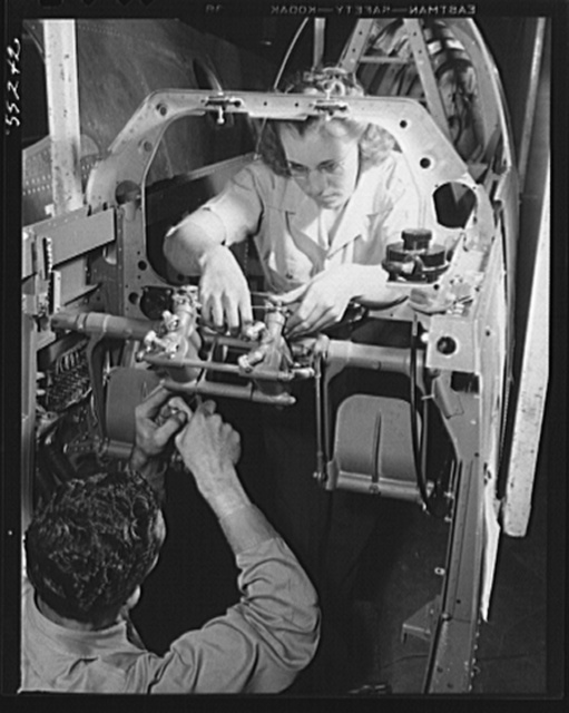 Inglewood, California. A man and woman working on rudder controls for a P-51 fighter plane at North American Aviation, Inc.