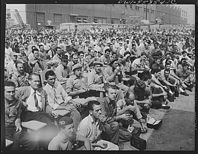 Inglewood, California. Employees enjoying a company program during their lunch hour at North American Aviation, Inc.