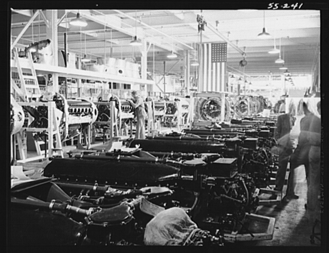 Inglewood, California. Interior view of the engine assembly department of North American Aviation, Inc., show long lines of mounted Allison motors for the B-51 fighter planes and Wright motors for the B-25 bomber planes (distant)