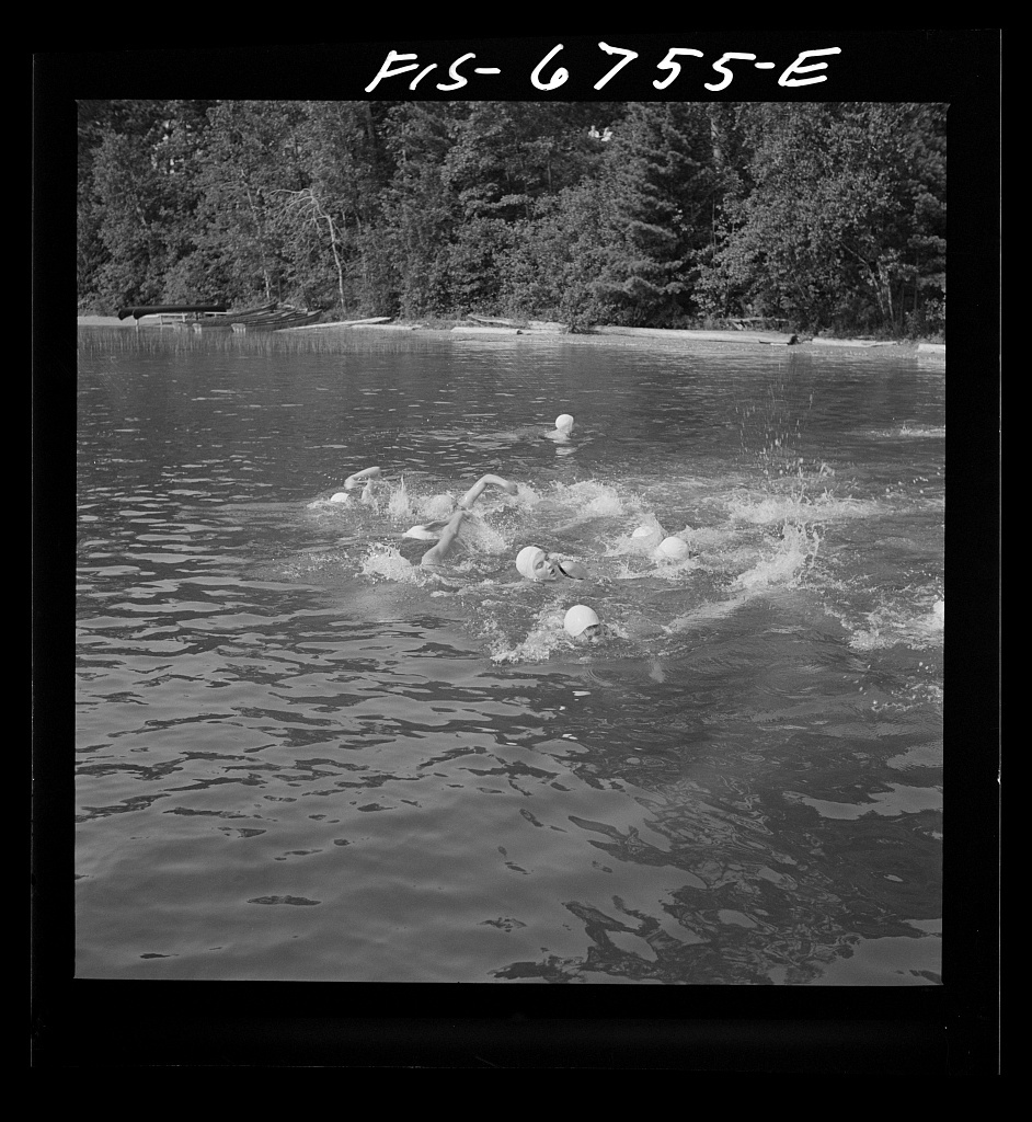 Interlochen, Michigan. National music camp where young musicians gather each summer for two months to study symphonic music. Girls swimming during the recreation period