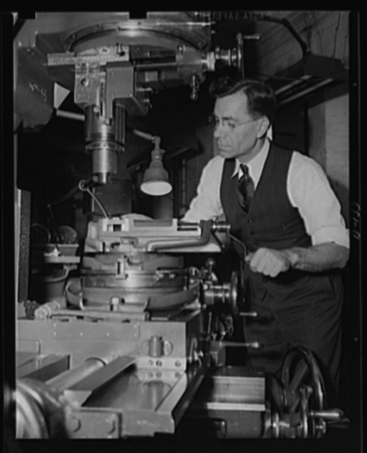Invention for defense. John C. Garand, inventor of the Army's semi-automatic rifle, at work in his model shop