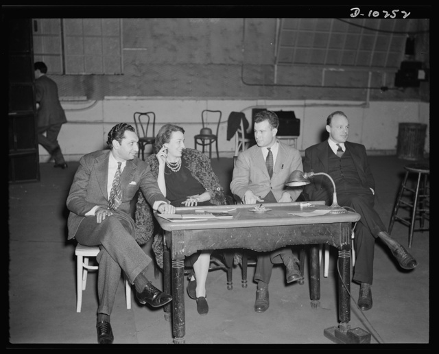 """Jack Schaindlin, musical director, Eleanor Herring, Philip Martin, Jr., technical director, Max Brasch, film editor,  at the Long Island Studios of the Army Signal Corps for the recording of Spencer Tracy's narration of the """"Ring of Steel,"""" an Office of Emergency Management (OEM) film, on February 19th, 1942"""