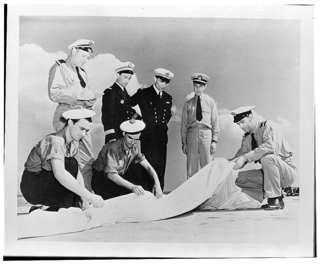 Jacksonville, Florida. Fighting French learning how to fold a parachute at the United States Naval air station
