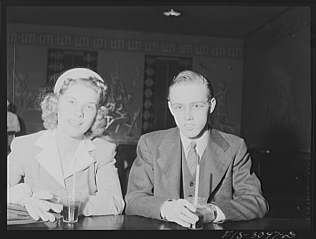 Jim Tillma and Antonette Skoda at soda fountain in student union. They will be married in June and move to Davenport, Iowa, where Jim will work for General Electric Company. University of Nebraska, Lincoln