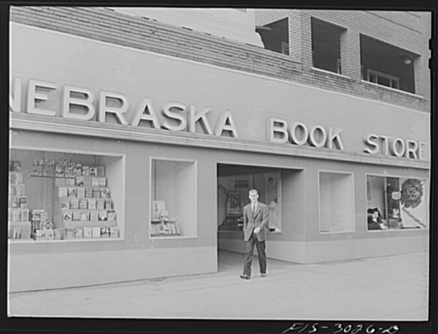 John Cockle coming out of the campus bookstore. University of Nebraska, Lincoln