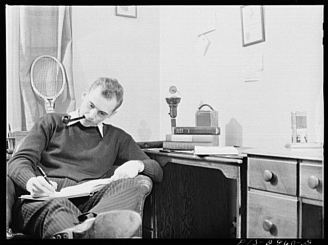 John Cockle in his room, studying for examinations. University of Nebraska, Lincoln