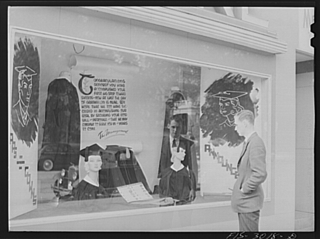 John Cockle looking at a cap and gown display. University of Nebraska, Lincoln
