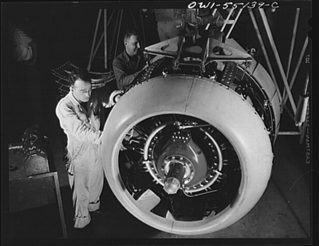 Kansas City, Kansas. Employees working on a motor assembly of a B-25 bomber at North American Aviation, Inc.