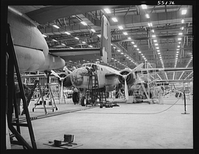Kansas City, Kansas. The interior of an assembly line, showing a B-25 bomber in the foreground of the North American Aviation Inc. plant