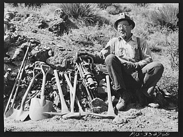 Kern County, California. Tungsten Chief Mine. Tungsten miner with his tools