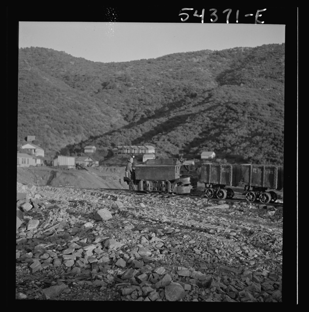 Kingman (vicinity), Arizona. A train of small cars carrying tungsten ore from the Boriana mines to a concentrating plant in the same area. The mine is about forty miles from Kingman