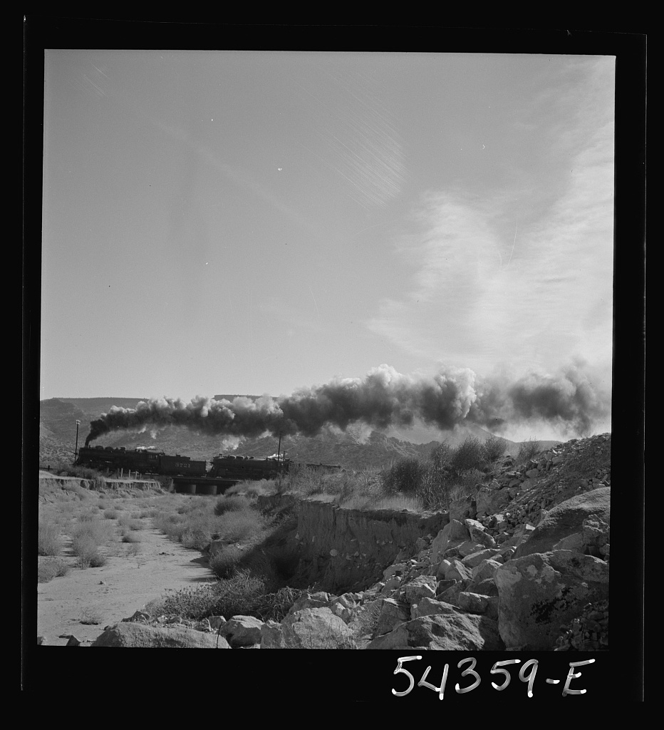 Kingman (vicinity), Arizona. A transcontinental train passing close to the tungsten recovery plant where the ore from the Boriana mines is processed