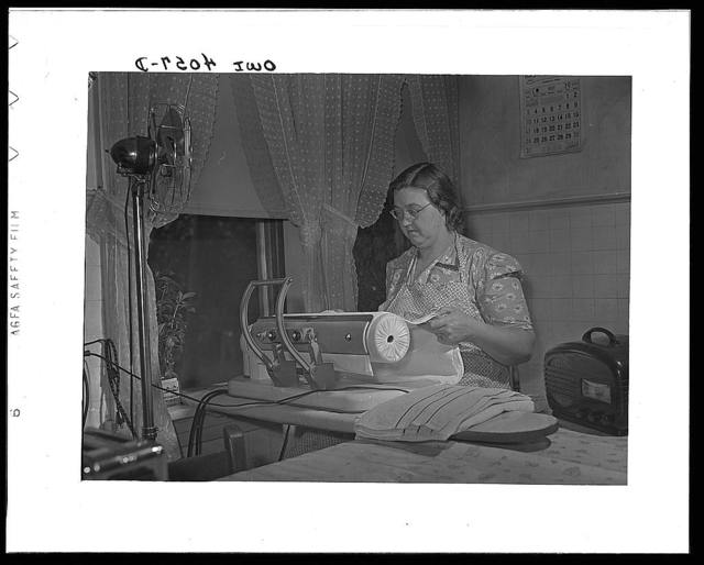 Knox County, Tennessee (Tennessee Valley Authority (TVA)). Mrs. Robert Bacon, farm wife, with some of her electric appliances - fan, ironer, radio