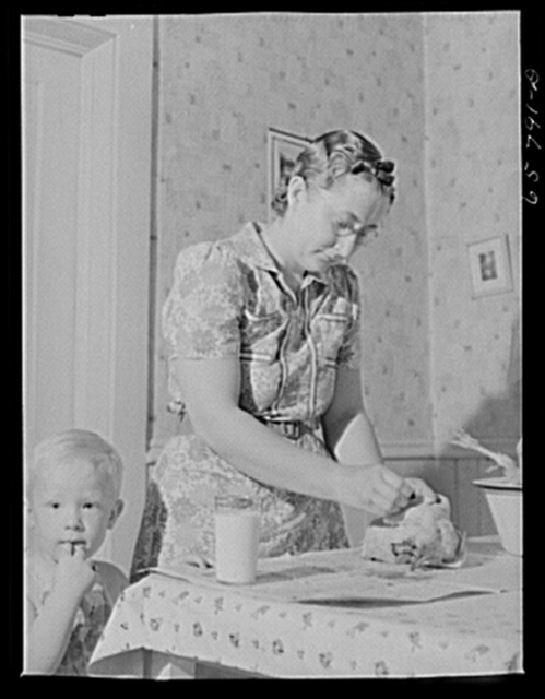 Lancaster County, Nebraska. Mrs. Lynn May, FSA (Farm Security Administration) borrower, cleaning a chicken