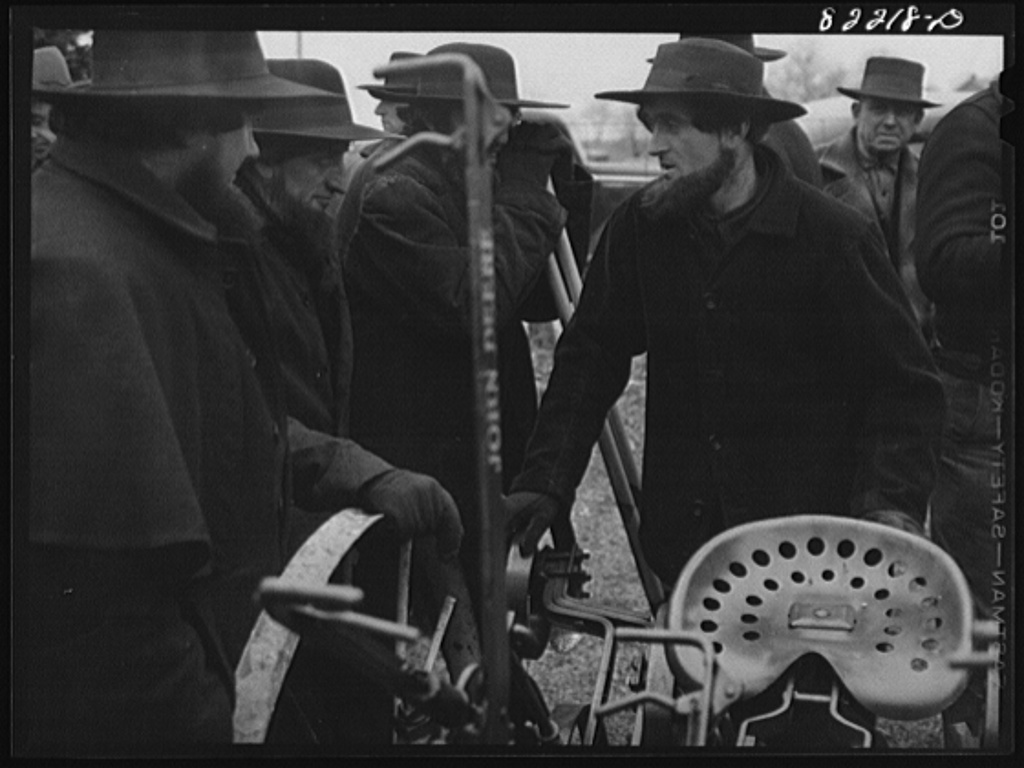 Lancaster County, Pennsylvania. Farm auction. Amish farmers cannot use tractor-drawn equipment on their lands, but can use horse-drawn cultivators providing they do not have rubber wheels