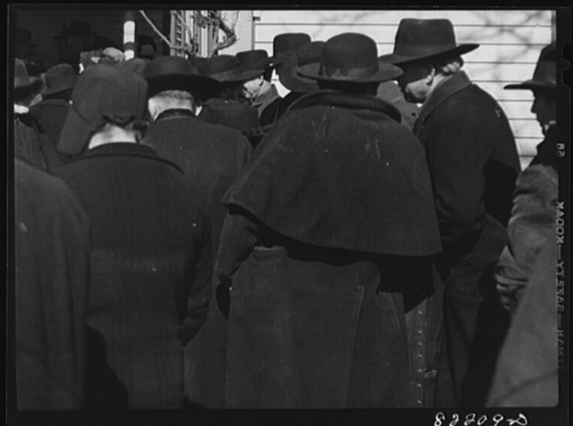 Lancaster County, Pennsylvania. Mennonite farmers drove in from the surrounding countryside in their black buggies to gossip and buy a needed piece of equipment for the coming year at a farm auction